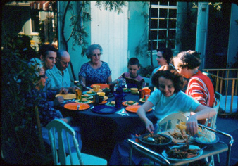 Early pic of family dining on patio
