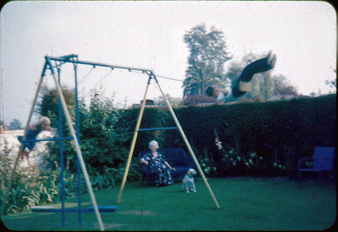 Lynn and Craig on swingset with Auntie May